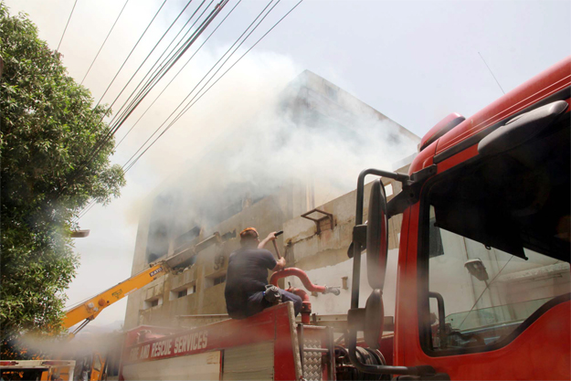 efforts continued on friday to put out flames at lucky textile mills photo ppi