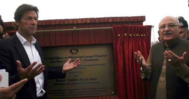 pti chief imran khan offers prayers after laying the foundation stone of the cancer hospital in peshawar photo inp
