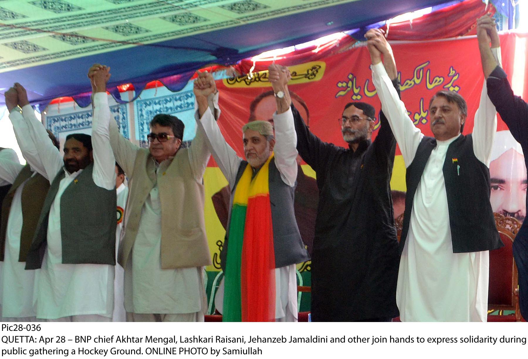 BNP-M chief Sardar Akhtar Mengal, Lashkari Raisani, Jehanzeb Jamaldini and others join hands to express solidarity. PHOTO: ONLINE