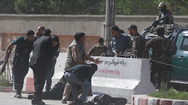 policemen help afghan journalists victims of a second blast photo reuters