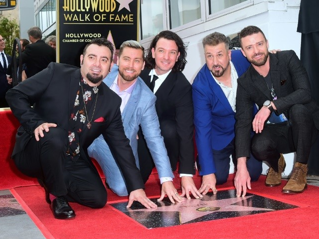 screaming fans flood hollywood as nsync reunites for walk of fame honour