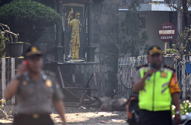 suspected islamic state inspired suicide bombers attack indonesian churches at least 11 dead