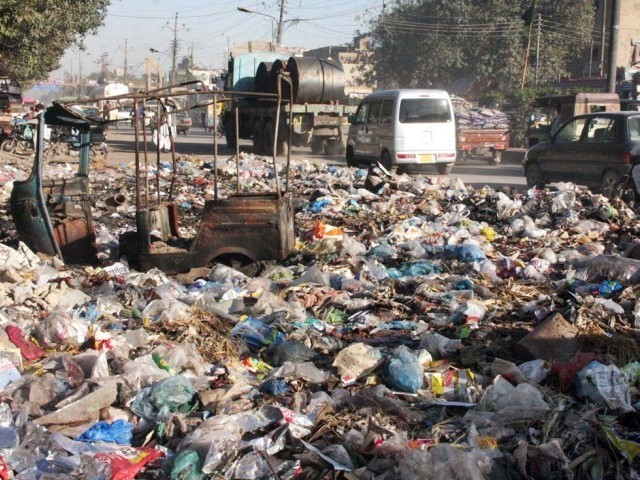 despite heaps of garbage across city solid waste budget slashed