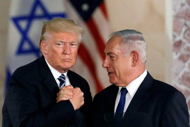 US President Donald Trump and Israeli Prime Minister Benjamin Netanyahu shake hands after Trump's address at the Israel Museum in Jerusalem. PHOTO: REUTERS