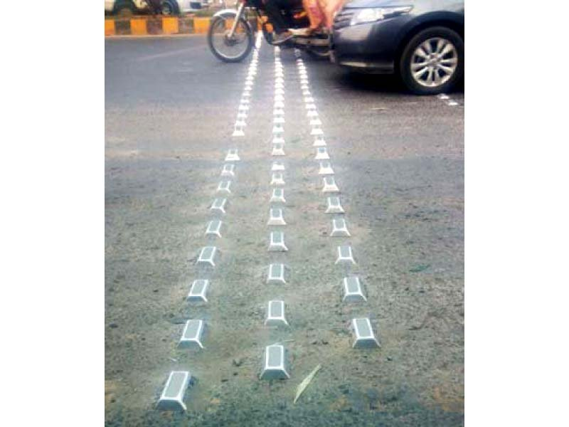 on the road commuters want large metal reflectors removed