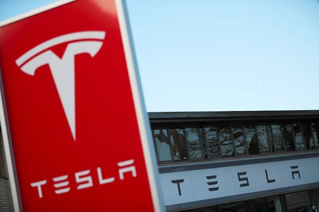 A Tesla dealership is seen in West Drayton, just outside London, Britain, February 7, 2018. PHOTO: REUTERS