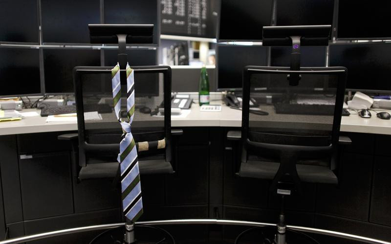 a tie hangs from an empty chair on a desk photo reuters