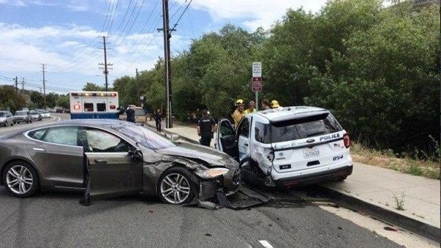A Tesla sedan is shown after it struck a parked Laguna Beach Police Department vehicle in Laguna Beach, California, US in this May 29, 2018. PHOTO: REUTERS