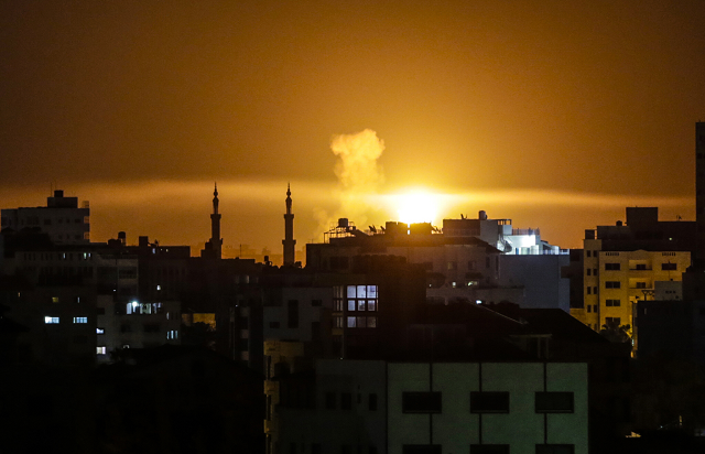 An explosion is seen in Gaza city after an airstrike by Israeli forces on June 2, 2018.   PHOTO: AFP