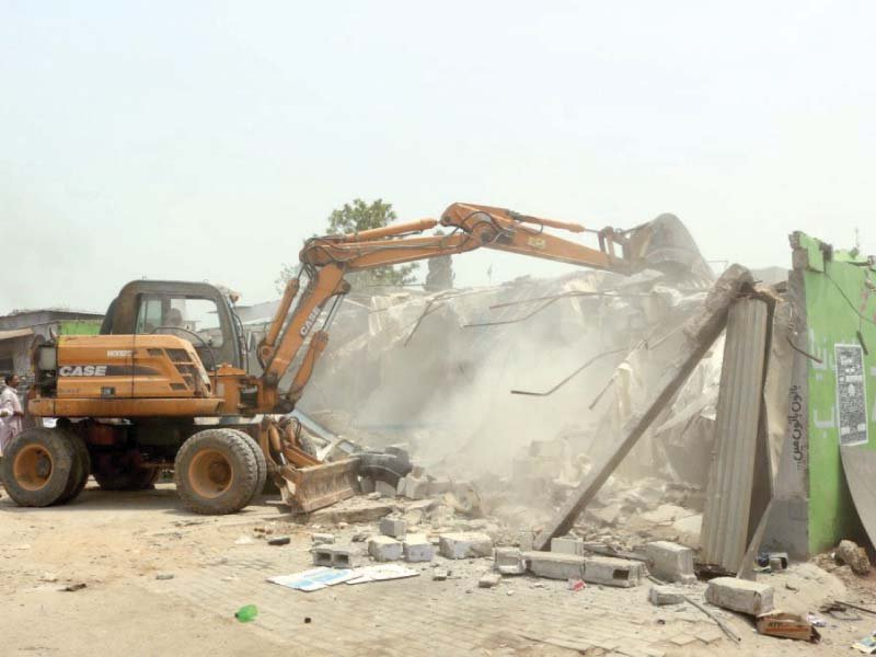 cda staff use an excavator to tear down encroachment photo express
