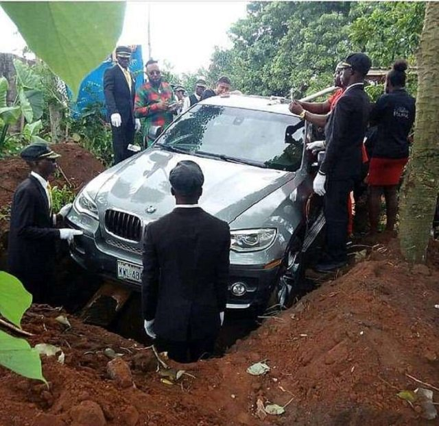 The picture has gone viral on social media as pall bearers reportedly guided it down logs into position and then the logs were pulled out to allow the vehicle to drop. Photo Courtesy: Jamie Pyatt News