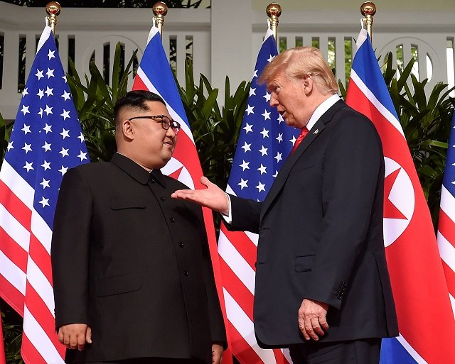 trump cracks fat joke gets priceless response from kim at singapore summit