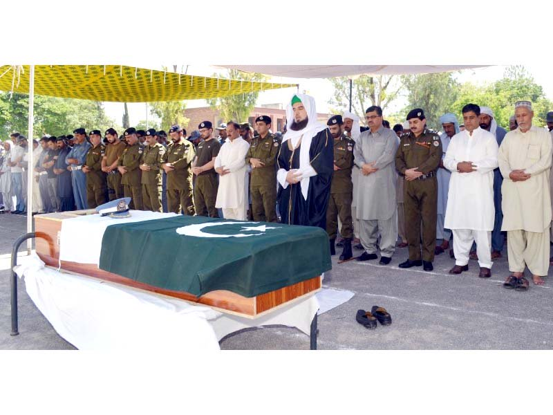Funeral prayers of Traffic Warden Shahid Sarwar who lost his life while performing his duties. PHOTO: ONLINE