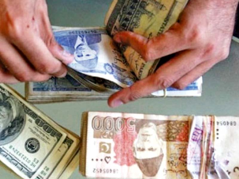 Currency dealers temporarily halt sales of dollar, other foreign currencies. PHOTO: FiLE