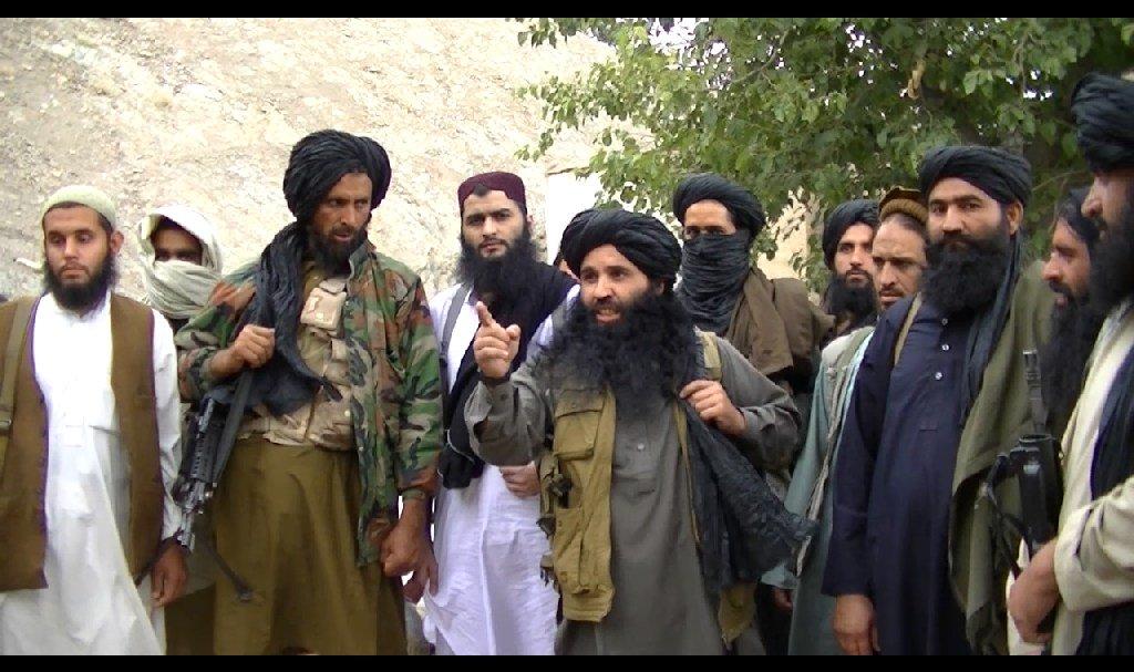 Mullah Fazlullah surrounded by men. PHOTO: FILE