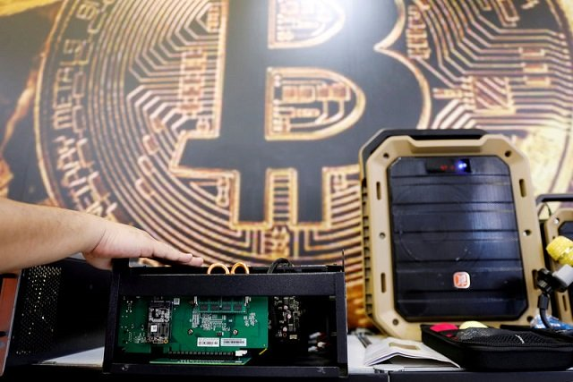a cryptocurrency mining computer is seen in front of bitcoin logo during the annual computex computer exhibition in taipei taiwan june 5 2018 photo reuters