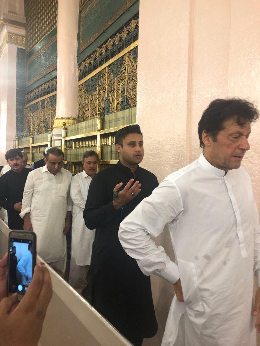 Zulfi Bukhari (left) with Imran Khan at Madinah. PHOTO: ZULFI BUKHARI/ TWITTER