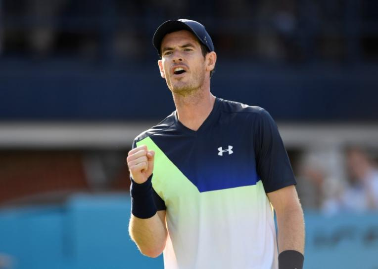 Great Britain's Andy Murray reacts during his first round match against Australia's Nick Kyrgios Action. PHOTO: AFP