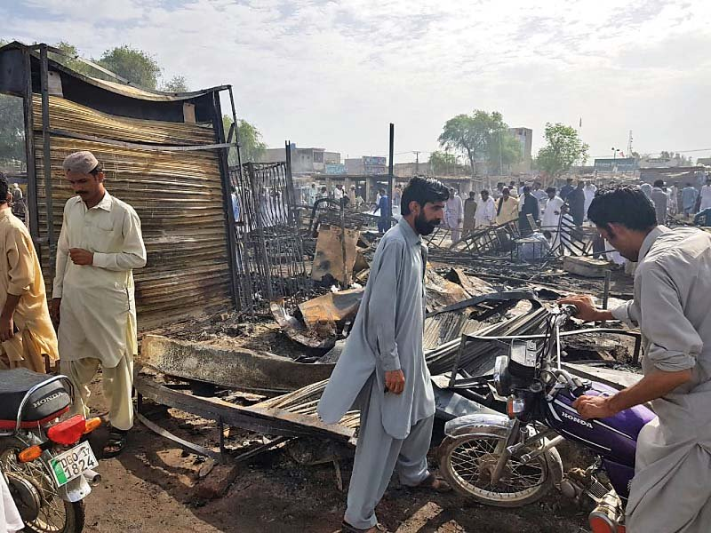 traders protest after shops burn down