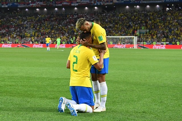 Brazil's defender Thiago Silva (L) is congratulated for his goal by Brazil's forward Neymar during the Russia 2018 World Cup Group E football match between Serbia and Brazil at the Spartak Stadium in Moscow on June 27, 2018. PHOTO: AFP