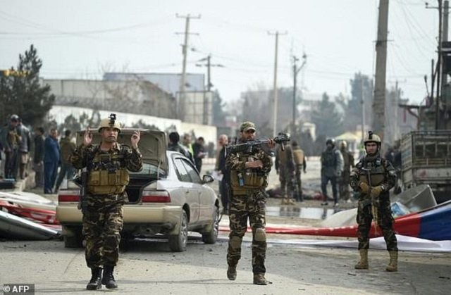 four also injured as they gather in support of peace in logar province photo afp file
