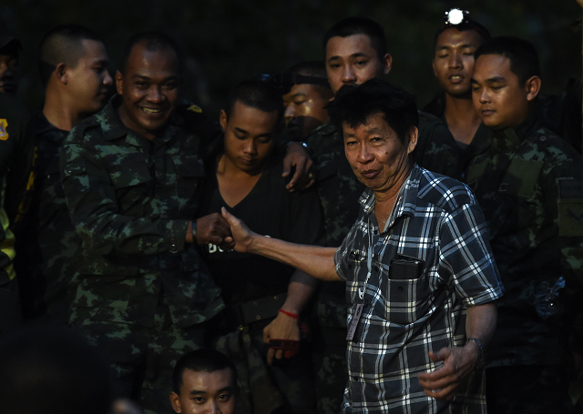 A father of a missing footballer thanks soldiers near Tham Luang cave following news all members of the children's football team and their coach were alive in the cave at Khun Nam Nang Non Forest Park in the Mae Sai district  PHOTO:AFP