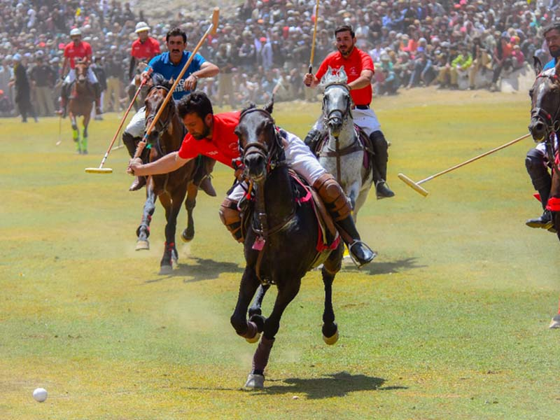 A view of the final polo match being played between Gilgit-Baltistan and Chitral at the Shandur polo festival in Chitral. PHOTO: EXPRESS