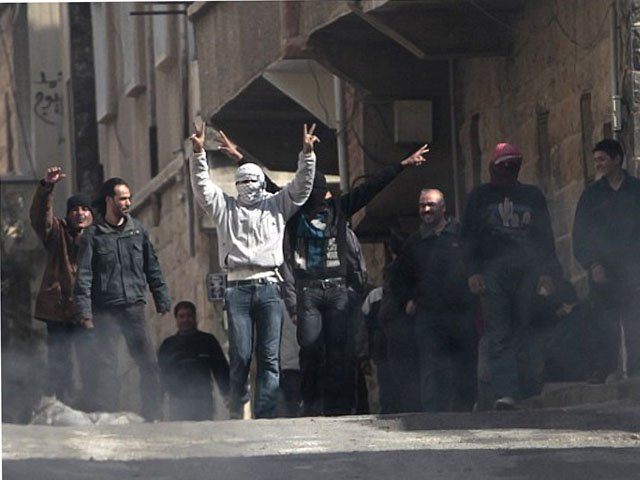 Daraa city the cradle of Syria's seven-year uprising fall back into government control. PHOT: AFP/ FILE