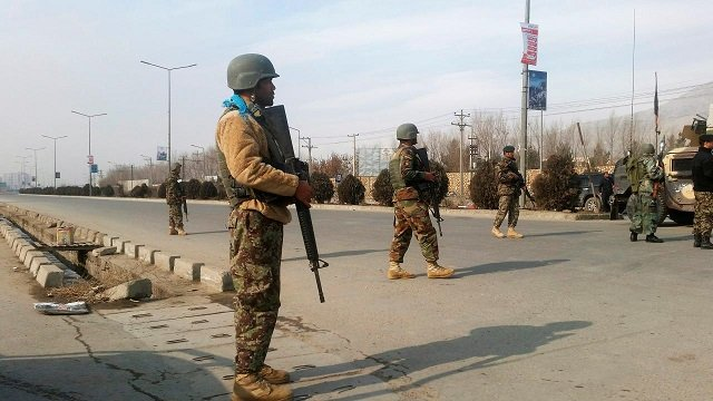 Afghan security forces keep watch at the site of an attack in Kabul, Afghanistan December 18, 2017.  PHOTO: REUTERS