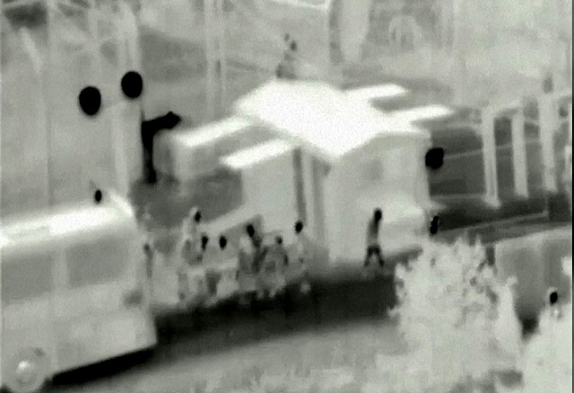 This handout video grab released by the Israeli Army on July 22, 2017, shows an evacuation operation of Syrian White Helmet rescuers and their families through Israel, in an unknown location, en route to Jordan after facing the threat of advancing Syrian regime forces in certain regions. PHOTO: AFP
