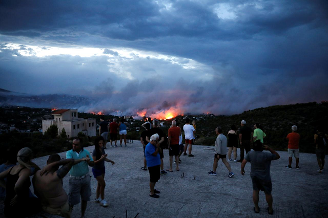 greece to begin laying wildfire victims to rest amid recriminations