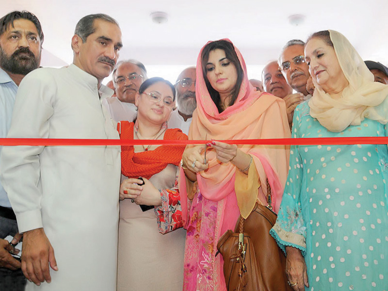 Leaders from the PML-N and Pakistan Muslim League-Likeminded appear together at the inauguration of the Lahore Cantonment General Hospital. PHOTO: SANA