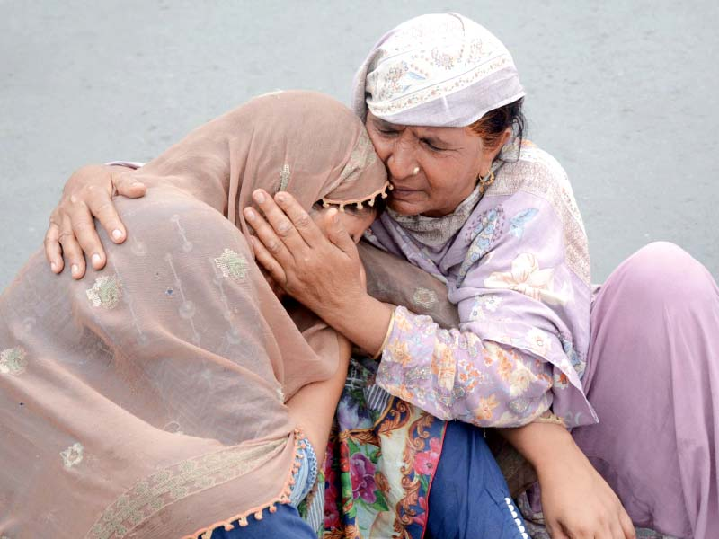 mourning relatives of the deceased stage a protest demonstration at faisal chowk photo online