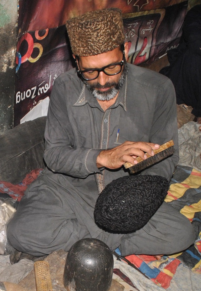Abbas followed in the footsteps of his forefathers who had the honour of dressing the heads of former prime ministers, presidents and other political notables. Ali, who lives in a small house in downtown Multan, knits these caps in the same building to make a living.. PHOTO: EXPRESS