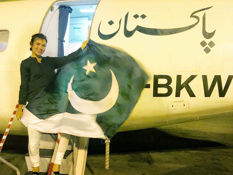 Eva zu Beck, the foreigner, can be seen in the video draped in the Pakistani flag and moving to the rhythm of a song. PHOTO COURTESY: TWITTER/PIA