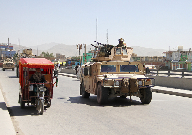 Afghan security forces convoy patrols the streets after a Taliban attack. PHOTO: REUTERS