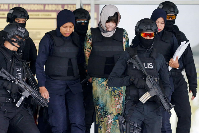 vietnamese doan thi huong who is on trial for the killing of kim jong nam the estranged half brother of north korea 039 s leader is escorted as she leaves the shah alam high court on the outskirts of kuala lumpur malaysia august 16 2018 photo reuters