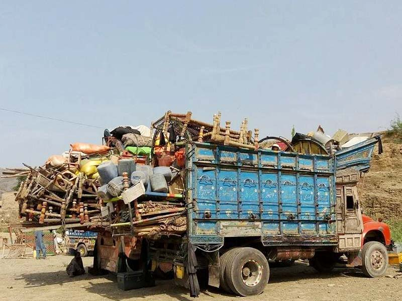 trucks carrying belongings of mohmand natives waits at torkham border photo express