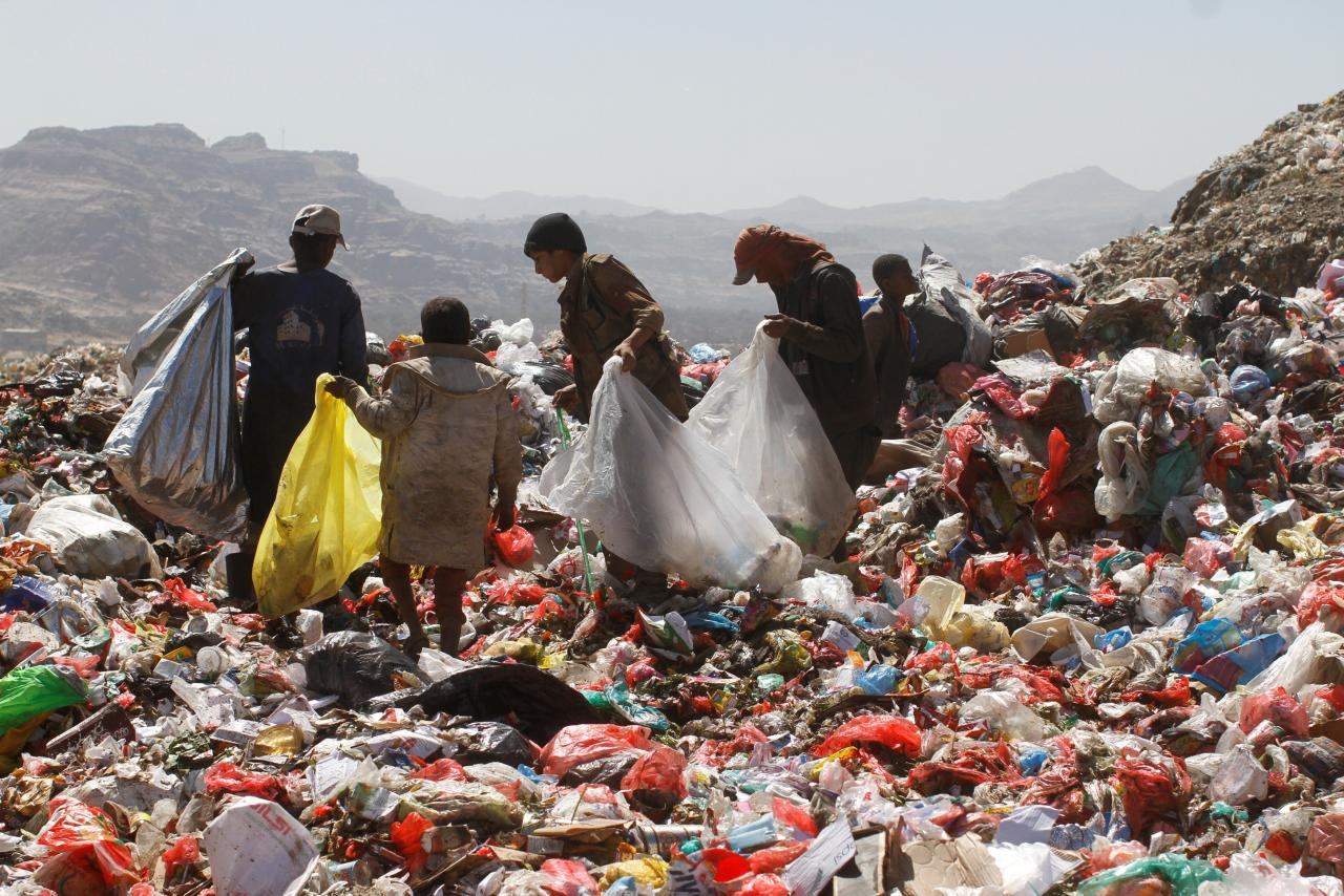 People collect recyclable items from piles of rubbish at a landfill site. PHOTO: REUTERS