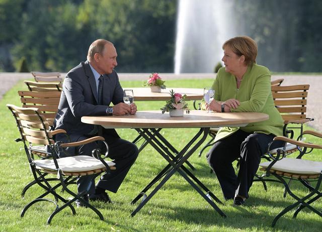 tough talks no agreements at merkel putin meeting near berlin