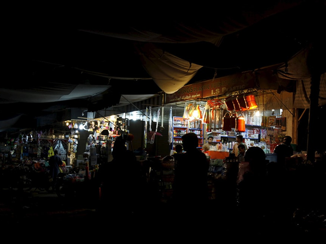 A general view of a market with shops powered by generators. Photo: Reuters