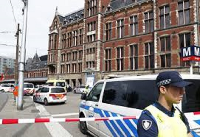 two us citizens hurt in dutch knife attack as police probe terror link