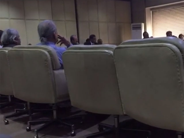 the former chairman senate is seen apparently smoking a cigar in the meeting of the senate committee video screen grab