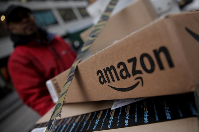 amazon boxes are seen stacked for delivery in the manhattan borough of new york city january 29 2016 photo reuters