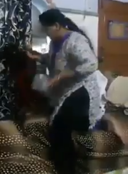 the video shows the woman slapping the young girl grabbing her by the ear screengrab
