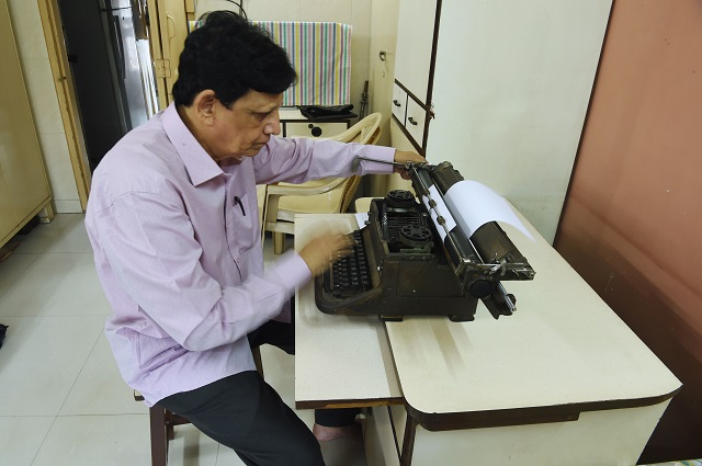 Indian artist, Chandrakant Bhide works on his typewriters. PHOTO: AFP