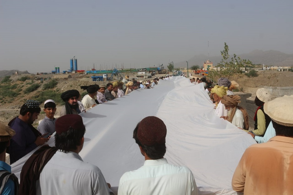 Security officials, locals took part in the ceremony. PHOTO: EXPRESS