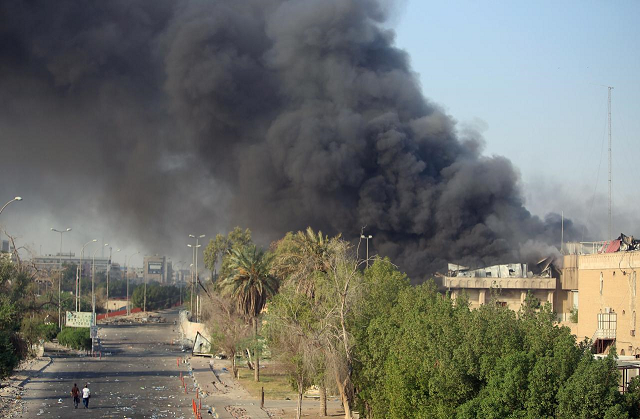 Smoke rises from the governorate and municipalities buildings of Basra, Iraq September 6, 2018.  PHOTO: REUTERS