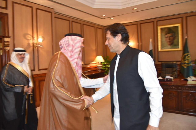 PM Imran greets Saudi information minister.  PHOTO: RADIO PAKISTAN