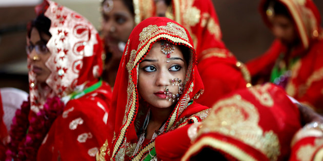 Brides sit and wait for their turn during a Muslim mass wedding in Ahmedabad, India. PHOTO: REUTERS